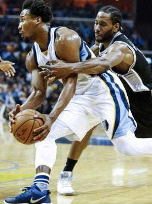 Memphis Grizzlies guard Wayne Selden (left) drives the lane against San Antonio Spurs defender Kawhi Leonard (right) during fourth quarter action in the fourth game of their NBA first round playoff series at the FedExForum.