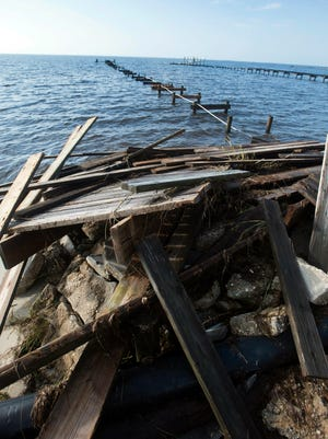Wind and water damage from Hurricane Nate leaves behind pier and dock damage in the Smuggler Cove subdivision in Gulf Breeze Monday, Oct. 9, 2017.