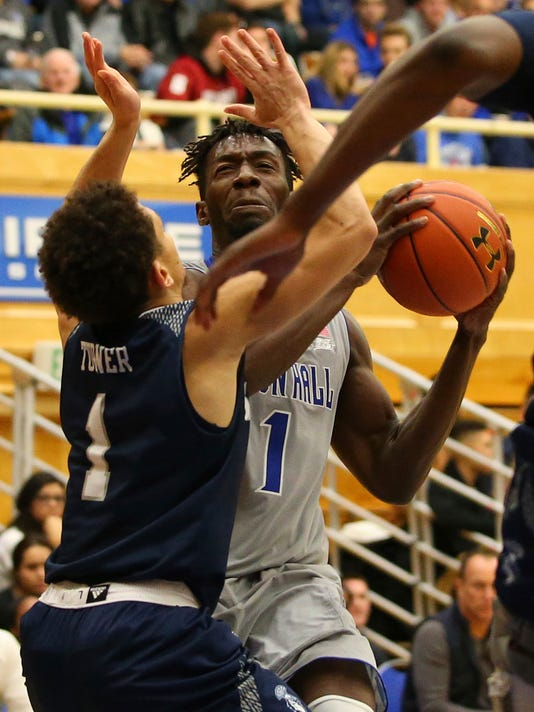 Seton Hall's Michael Nzei, right,  attempts a shot as St. Peter's Davauhnte Turner, left,  defends during the first half of an NCAA college basketball game in South Orange, N.J., Tuesday, Dec. 12, 2017. (AP Photo/Rich Schultz)