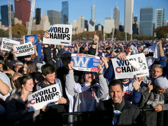 Chicago Cubs fans celebrate before a rally in Grant