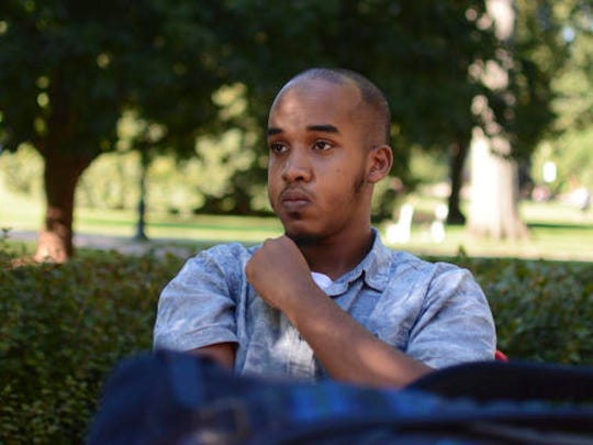 """FILE - This August 2016 file photo provided by TheLantern.com shows Abdul Razak Ali Artan in Columbus, Ohio. Authorities identified Artan as the Somali-born Ohio State University student who plowed his car into a group of pedestrians on campus and then got out and began stabbing people with a knife Monday, Nov. 28, 2016, before he was shot to death by an officer. The attack employed methods Islamic State extremists have suggested in a slick new online magazine. It isn't clear whether Artan ever saw or heard about the magazine's instructions, but in a Facebook post made before the attack, he said that if the U.S. wanted Muslims to stop carrying out """"lone wolf attacks,"""" it should make peace with the Islamic State group. The posts were recounted by a law enforcement official who was briefed on the investigation but wasn't authorized to discuss it publicly and spoke to The Associated Press on condition of anonymity."""
