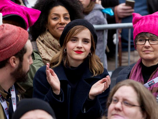 Actress Emma Watson sits in the crowd during the Women's March on Washington, Saturday, Jan. 21, 2017 in Washington.