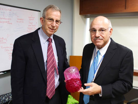 Dr. David Hoffman, left, and Dr. Armen Kasabian, hold