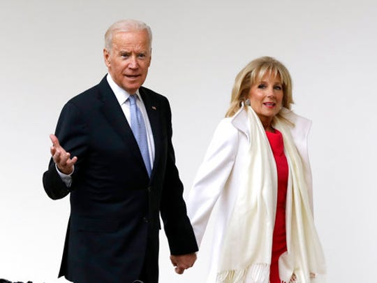 """FILE - In this Jan. 20, 2017 file photo, Vice President Joe Biden and his wife Jill walk along the colonnades of the White House in Washington before the start of presidential inaugural festivities for the incoming 45th President of the United States Donald Trump. Flatiron Books said Wednesday, April 5, that it will release two books by Joe Biden and one by Jill. Joe Biden's first book will """"explore one momentous year,"""" 2016, when his son Beau died and he decided against running for president. The book is currently untitled and no release date was announced."""