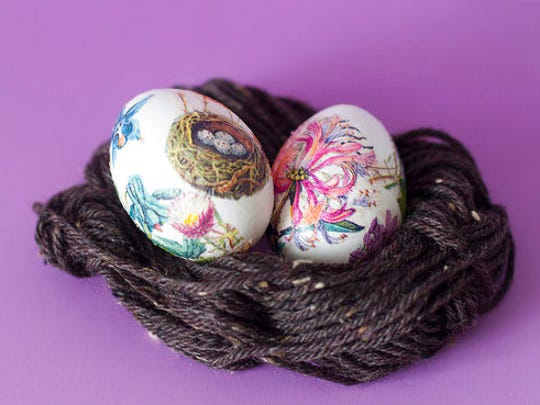 This April 6, 2017 photo taken in Hopkinton, N.H., shows two Easter eggs decorated with designs cut from paper napkins. This technique uses real eggs with the contents blown out, so the results, while pretty, are fragile.