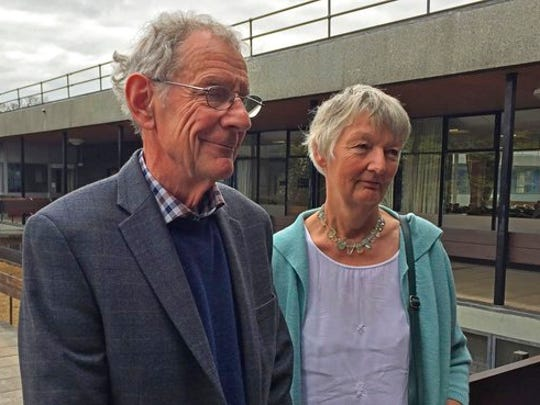 """Graham and Meg Hemmings who previously owned a piano where a stash of gold was found are photographed in Shrewsbury England Thursday April 20, 2017. As a mystery surrounds the identity of the rightful heirs to a treasure trove of gold coins. British officials say they have been unable to trace the rightful heirs to a trove of gold coins  worth a """"life-changing"""" amount of money. The school that owns the piano and the tuner who found the gold are now in line for a windfall after a coroner investigating the find declared it treasure."""