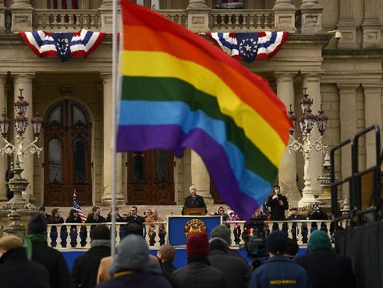 An LGBT supporter attended Michigan Gov. Rick Snyder's