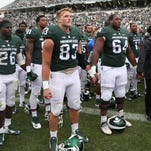 Michigan State players joined Air Force as they sing the Air Force fight song at the end of the game on Sept. 19, 2015, at Spartan Stadium in East Lansing.