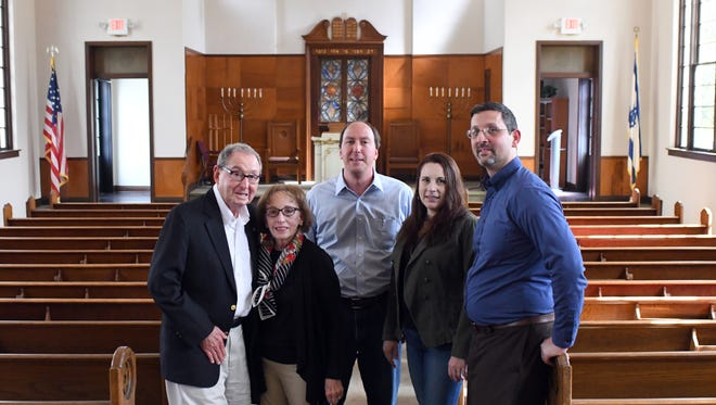 Brian and Heather Rifkin, right, and Jerry, Linda and David Shemper, left, are part of the B'nai Israel Temple congregation in Hattiesburg. The Temple B'nai Israel was recently listed on the National Register of Historic Places.