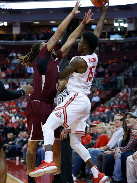 Ohio State's Kam Williams, right, saves the ball from going out of bounds as Texas Southern's Kevin Scott defends during the second half of an NCAA college basketball game Thursday, Nov. 16, 2017, in Columbus, Ohio. (AP Photo/Jay LaPrete)
