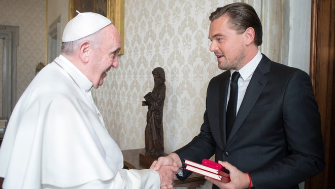 Pope Francis welcomes Leonardo DiCaprio during a private audience at the Vatican, Jan. 28, 2016.