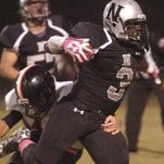 Northwest's Chris Lee runs for three toucdowns in win over Pine Prairie.