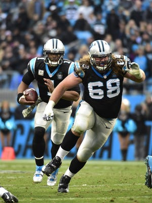 Carolina Panthers quarterback Cam Newton (1) runs as guard Andrew Norwell (68) blocks in the fourth quarter. Norwell is an Anderson Township native, member of the Redskins 2007 Division II state championship team, and former Ohio State Buckeye.