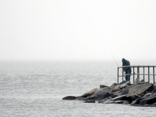 A fisherman calls it quits as the rain picked up at