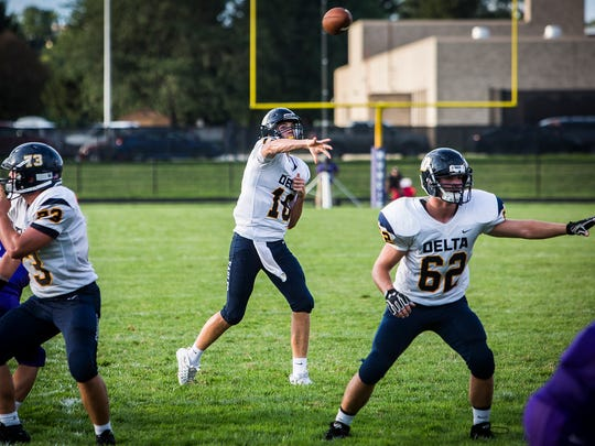 Delta's Brady Hunt throws a pass while Evan Conley