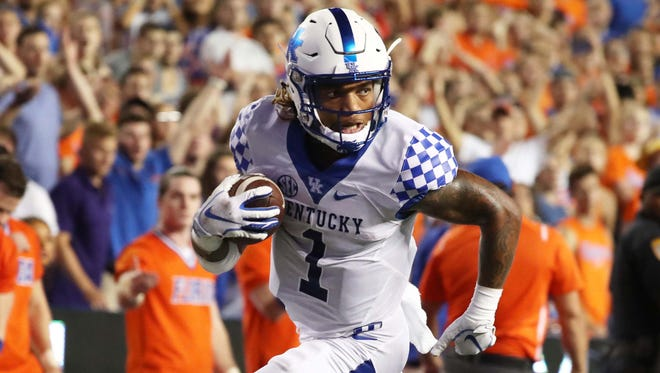 Sep 8, 2018; Gainesville, FL, USA; Kentucky Wildcats wide receiver Lynn Bowden Jr. (1) catches the ball and runs it in for a touchdown against the Florida Gators at Ben Hill Griffin Stadium. Kentucky Wildcats defeated the Florida Gators 27-16. Mandatory Credit: Kim Klement-USA TODAY Sports