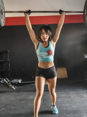Keomi Pangelinan performs a clean and jerk lift at CrossFit Latte Stone in Tamuning on May 9, 2015.