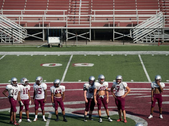 Alcoa High School players at football practice on Monday, July 24, 2017.
