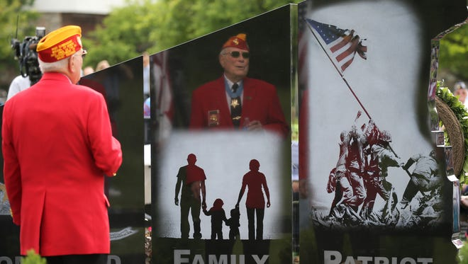 """Medal of Honor recipient Hershel """"Woody"""" Williams, 92, has his image reflected in the new memorial for Gold Star Families that was erected in White Haven Memorial Park.  It is one of 10 in the country."""