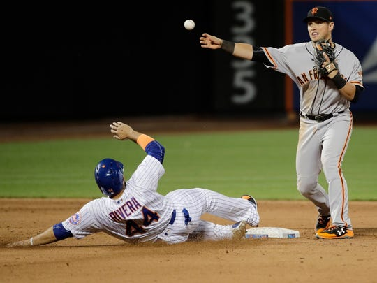 San Francisco Giants' Joe Panik throws to first base after forcing out New York Mets' Rene Rivera during the sixth inning of a baseball game, Monday, May 8, 2017, in New York. New York Mets' Juan Lagares was safe at first base on the play. (AP Photo/Frank Franklin II)