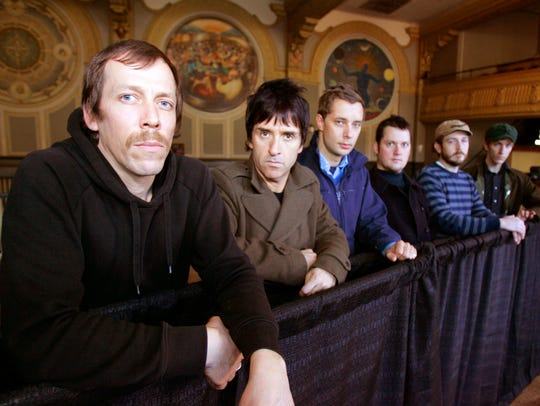 "Members of band ""Modest Mouse"", from left, Tom Peloso, Johnny Marr, Joe Plummer, Isaac Brock, Eric Judy and Jeremiah Green pose for a photo at the Crystal Ballroom in Portland, Ore., in this March 14, 2007 file picture. (AP Photo/Don Ryan)"