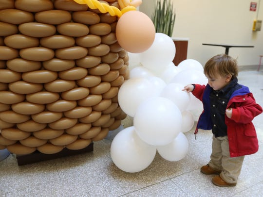 Elek Veniskey, 18 months old, admires some balloons