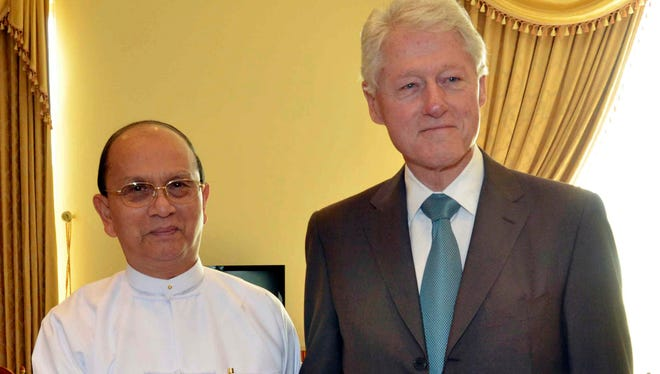 Myanmar President Thein Sein shakes hands with former U.S. President Bill Clinton, during their meeting in Naypyitaw, Myanmar, on Nov. 14.