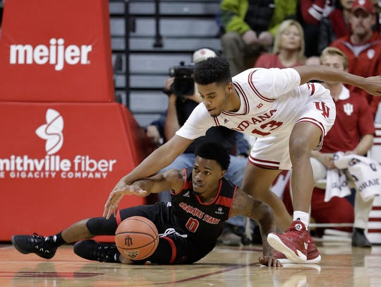 Arkansas State's Ty Cockfield and Indiana's Juwan Morgan