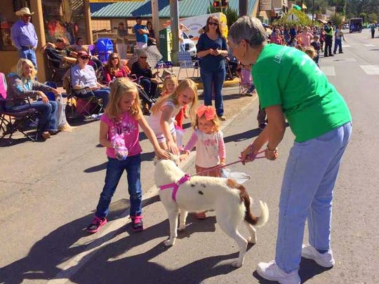 Members of the Humane Society of Lincoln County introduced dogs waiting at the shelter for adoption to parade goers.