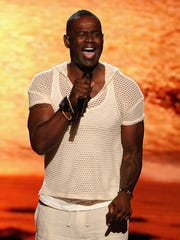Singer Brian McKnight performs at the 2014 ESPYS. McKnight