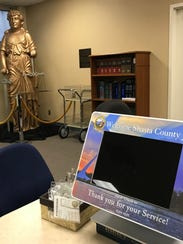 One of several touch-screen computers allows prospective jurors to quickly check in for jury duty.