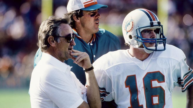 Dolphins coach Don Shula talks with quarterback David Woodley (16) on the sideline during a game against the Minnesota Vikings at the Orange Bowl in December 1982.