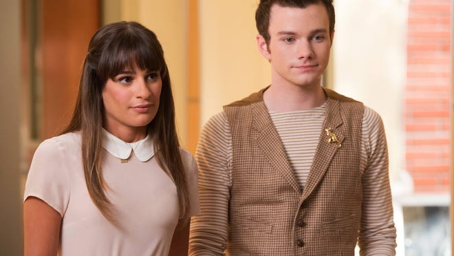 """This photo released by Fox shows, Lea Michele, left, and Chris Colfer, in a scene from """"Glee."""" The media advocacy group GLAAD on Wednesday, Oct. 1, 2014, released its annual report on diversity on TV, including depictions of gay characters."""