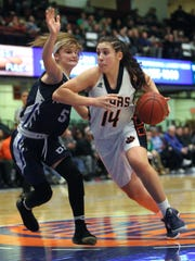 Briarcliff's Maddie Plank drives on Putnam Valley's Arianna Stockinger during their Class B semifinal at the Westchester County Center Feb. 26, 2018.