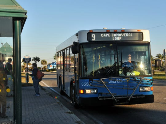 A Space Coast Area Transit bus stops at the Shepard