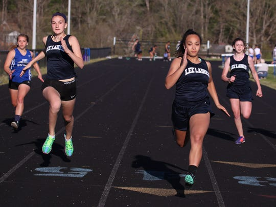 R.E. Lee's Makayla Hackett, center, cruises in for a first place finish as teammate Anna Moore, left, places second in the 100 meter dash at the track meet hosted by R.E. Lee on Wednesday, April 20, 2016.