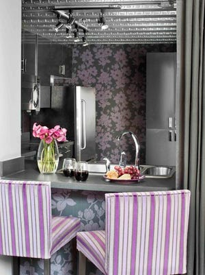 This industrial loft kitchen was updated using floral wallpaper with modern scale and colors.