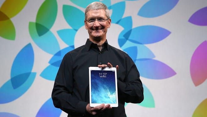 Apple CEO Tim Cook holds the iPad Air during an Apple announcement at the Yerba Buena Center for the Arts on October 22, 2013 in San Francisco.