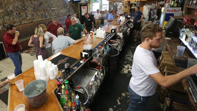 Patrons gather for an early evening drink at Ken's Tavern on Friday, July 22, 2016.