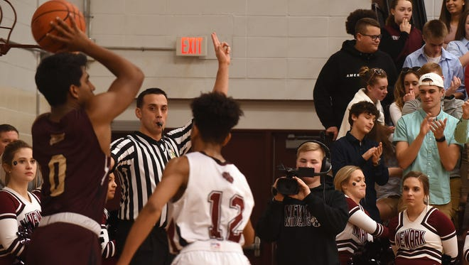 Newark sophomore Drew Carr films during a Newark home game against New Albany on Friday, Jan. 19, 2018.