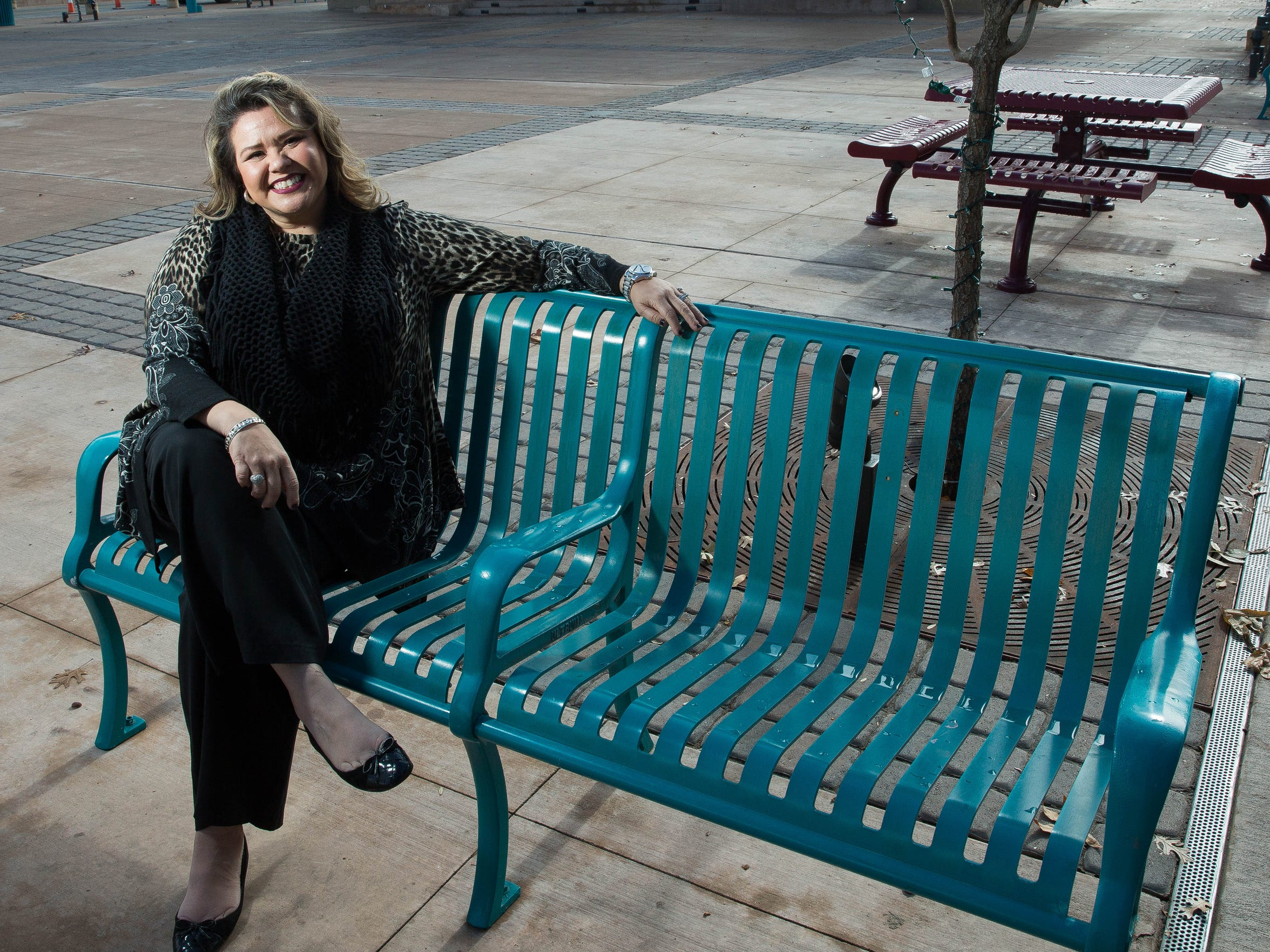 Jennifer L. Garcia Kozlowski, the executive director of the downtown Las Cruces Partnership sits in a bench along Main Street.  One of her goals in her new position is to work more closely with downtown merchants in an effort to retain the businesses that have been recruited to the downtown district in recent years.