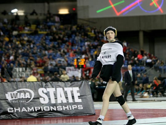 Holly Beaudoin paces on the mat before her state championship match against Olyvia Smith of Zillah on Feb. 17.