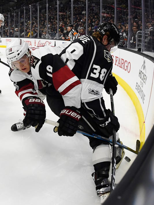 Arizona Coyotes center Christian Dvorak, left, and Los Angeles Kings defenseman Paul LaDue tangle during the first period of an NHL hockey game, Thursday, Feb. 16, 2017, in Los Angeles. (AP Photo/Mark J. Terrill)