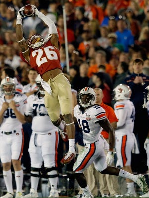 Florida State cornerback P.J. Williams (26) intercepts a pass in the fourth quarter against the Auburn en route to the Seminoles third national championship in program history.