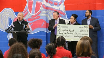 """Forest County Potawatomi Chairman Harold """"Gus"""" Frank (left) speaks about community safety after presenting a $45,000 grant from the tribe's foundation to Ald. Bob Donovan (middle) and Milwaukee Common Council President Ashanti Hamilton (right). Kaye Garcia, executive director of the Forest County Potawatomi Foundation, joins them."""