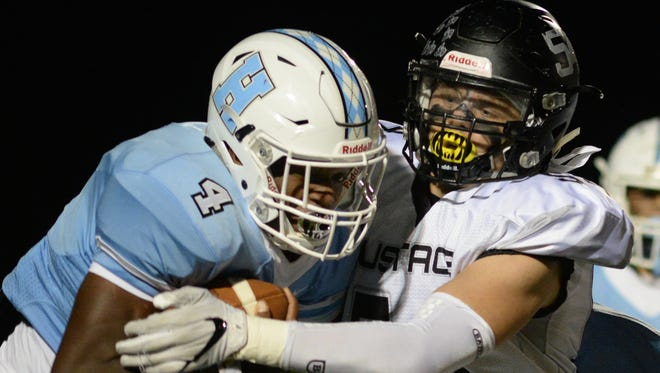 Bishop Eustace's Nicholas Martorell tackles Highland's Daejaun Sanders during a 10-0 victory on Friday night.