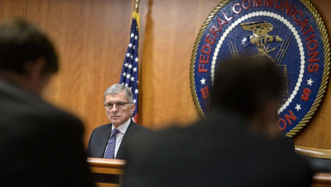 Federal Communication Commission (FCC) Chairman Tom Wheeler waits for a hearing at the FCC Dec. 11, 2014 ,in Washington, DC.
