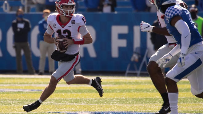 Georgia quarterback Stetson Bennett (13) during the Bulldogs' game with Kentucky in Lexington, Ky., on Saturday, Oct. 31, 2020.