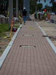 A partly finished brick sidewalk is visible along SE 47th Terrace in downtown Cape Coral as part of the streetscape rennovation process.