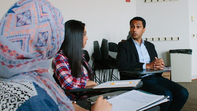 Eboo Patel, founder of Interfaith Youth Core in Chicago, talks with visitors at the center.